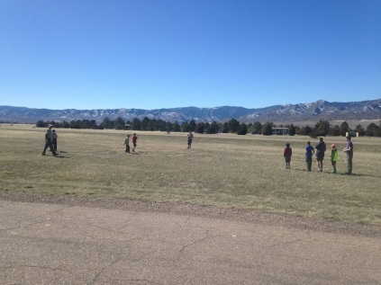 Troop members relaxing to some kickball before a long day of work.